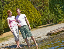 Couple standing near stream Stock Image