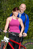 Couple Standing Next to Bike - Vertical Stock Photo