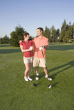 Couple Standing On Golf Course - Vertical Stock Image