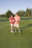 Couple Standing On Golf Course - Vertical Royalty Free Stock Photography