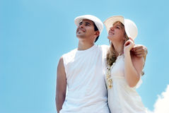 Couple standing outdoors smiling Stock Photos