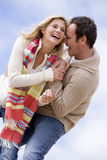 Couple standing outdoors smiling Stock Photo