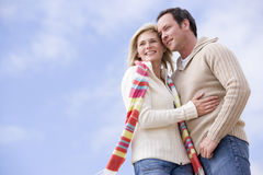 Couple standing outdoors smiling stock image