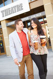 Couple Standing Outside Cinema Together Stock Photos