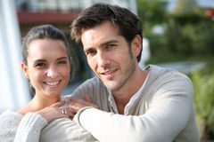 Couple standing outside in front of their house Royalty Free Stock Photos