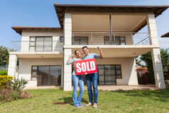 Couple standing outside house Stock Photo