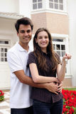 Couple standing outside new house royalty free stock image