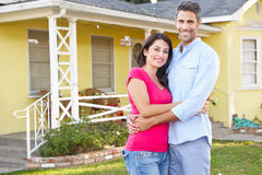 Couple Standing Outside Suburban Home Royalty Free Stock Photography