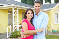 Couple Standing Outside Suburban Home Royalty Free Stock Photos