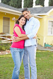 Couple Standing Outside Suburban Home Stock Photo