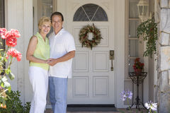 Couple Standing Outside Their House royalty free stock photos