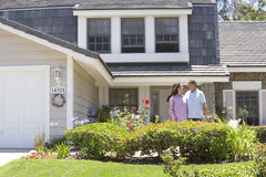 Couple Standing Outside Their House Royalty Free Stock Photo