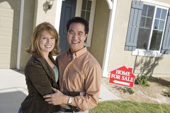 Couple Standing Outside Their New House Stock Photos