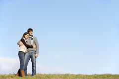 Couple Standing In The Park Royalty Free Stock Photo