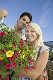 Couple standing in plant nursery royalty free stock image