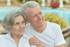 Couple standing by pool Stock Image