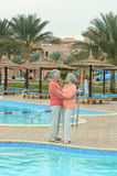 Couple standing by pool Stock Photography