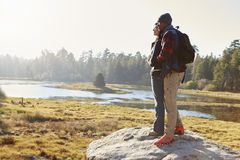 Couple standing on a rock in countryside, admiring the view Royalty Free Stock Photo