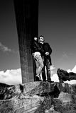 Couple standing on rock under arch Royalty Free Stock Image