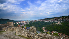 Couple standing at the ruins of the old fortress and looking at Cityscape of Plovdiv city, Bulgaria. Panoramic View over skyline. Stock Photo