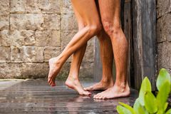 Couple standing in shower together. Woman and man standing in shower together Stock Photos