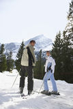 Couple Standing On Ski Slope Royalty Free Stock Images