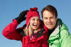 Couple Standing In Snow Stock Images