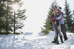 Couple Standing On Snow Covered Hill Stock Photos