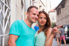 A couple standing on the street and having fun. Positive emotion Royalty Free Stock Photo