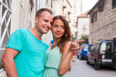 A couple standing on the street and having fun. Positive emotion Stock Image