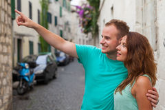 A couple standing on the street and using smartphone. Stock Photography