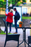 Couple standing at the summer cafe table with flowers Stock Photos