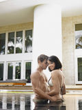 Couple Standing In Swimming Pool Royalty Free Stock Image