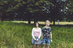 Couple standing among tall grass Stock Photography