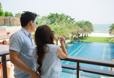 Couple standing at the terrace and looking to sea Stock Image