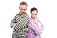 Couple standing to each other with folded arms royalty free stock image