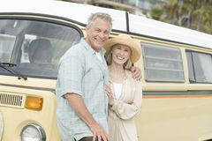 Couple Standing Together Against Campervan Stock Photography