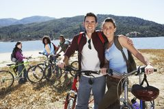 Couple Standing Together By Bicycle Stock Photo