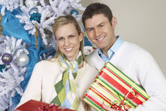 Couple Standing Together With Christmas Gifts Stock Photo