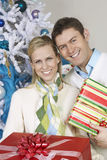 Couple Standing Together With Christmas Gifts Royalty Free Stock Images