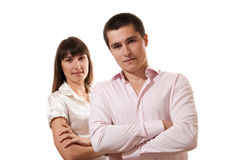 Couple standing together with folded arms Royalty Free Stock Photos