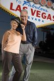 Couple Standing Together With 'Las Vegas' Sign In The Background Stock Images