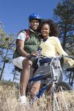 Couple Standing Together With Mountain Bikes Royalty Free Stock Photography