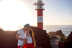 Couple standing together near the lighthouse Stock Images
