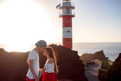 Couple standing together near the lighthouse Royalty Free Stock Photos