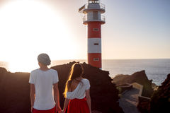 Couple standing together near the lighthouse Stock Photos
