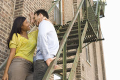 Couple Standing Together On Steps Stock Photography