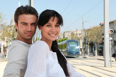 Couple standing by the tram Stock Photos