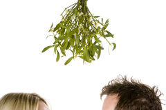 Couple standing under mistletoe Stock Image