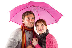 Couple standing underneath an umbrella Royalty Free Stock Images
